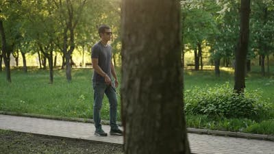 Blind Man Walks with a Cane at the Park