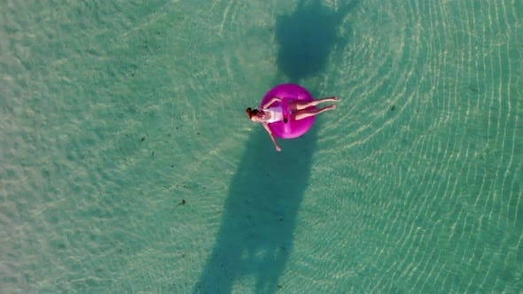 Thumbnail for A Woman Swims in the Sea, Top View.