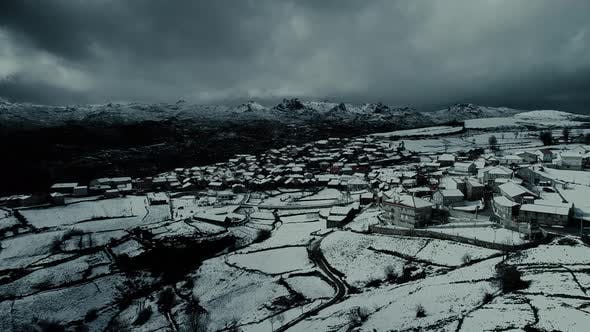 Thumbnail for Aerial View of the Snow-covered Village at Night