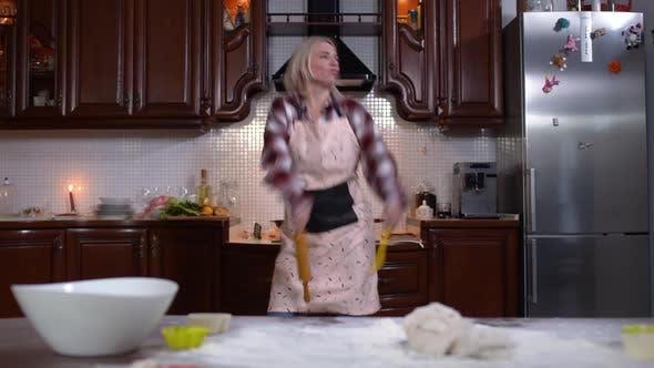 Thumbnail for Wide Shot of Joyful Caucasian Young Woman Dancing in Kitchen at Home