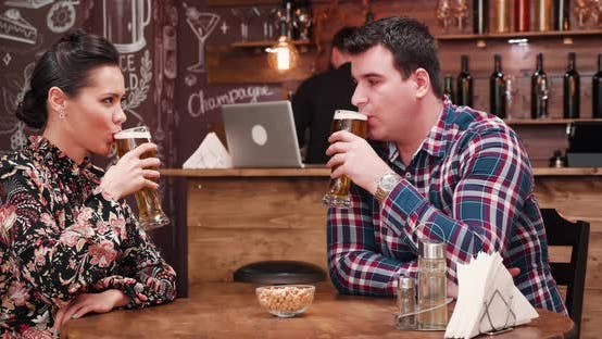Thumbnail for Happy Smiling Couple Clink Their Glasses with Beer