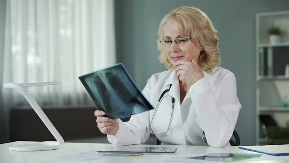 Experienced Female Radiologist Studying X-Ray Picture Qualified Diagnostics