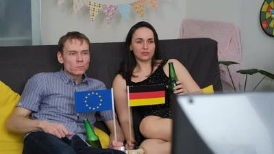European Couple Watching Olympic Games on TV