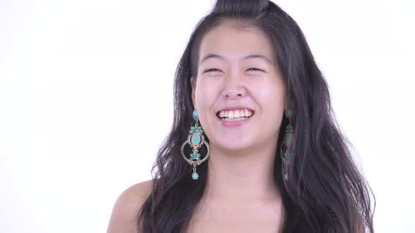Cover Image for Face of Happy Beautiful Asian Woman Thinking Ready To Party