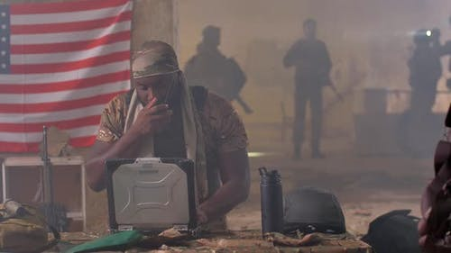 US Army Man Planning Military Operation at Laptop