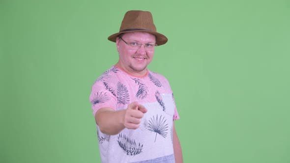 Thumbnail for Happy Overweight Bearded Tourist Man Pointing at Camera