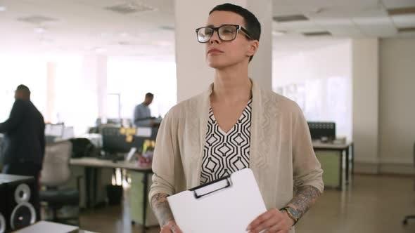 Thumbnail for Confident Female Entrepreneur Walking through Office