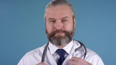 Bearded Physician with Stethoscope Posing for Camera