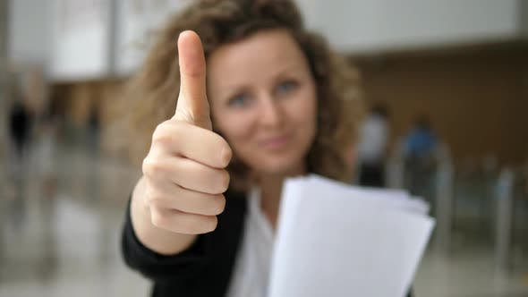 Thumbnail for Successful Business Woman Smiling Showing Thumbs Up In Camera