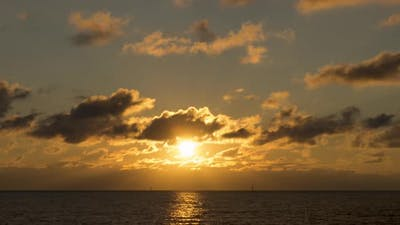 Clouds are Swirling in the Golden Rays of the Sun