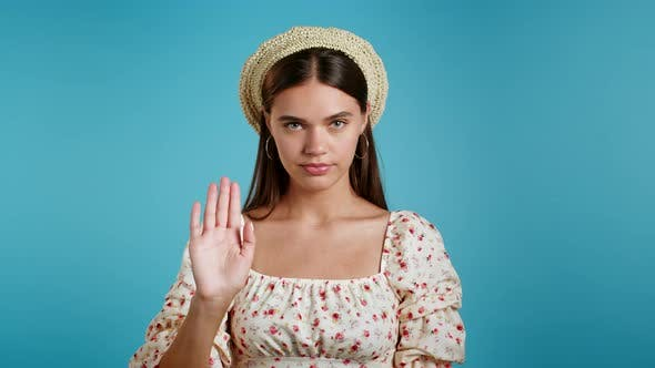 Woman Disapproving with NO Hand Make Negation Gesture. Denying, Rejecting, Disagree, Portrait of