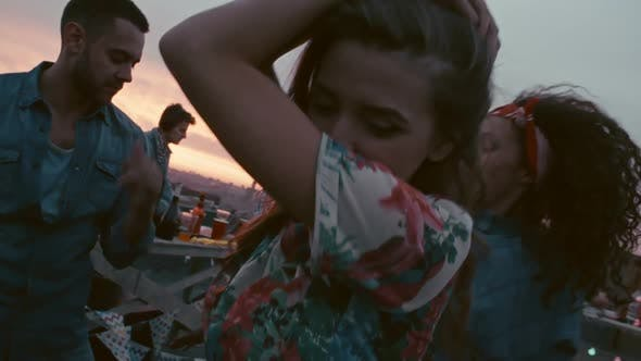 Thumbnail for Beautiful Woman Partying with Friends on Rooftop