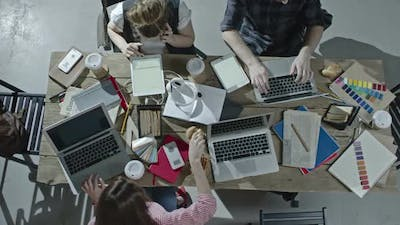 Design Team Working at Table