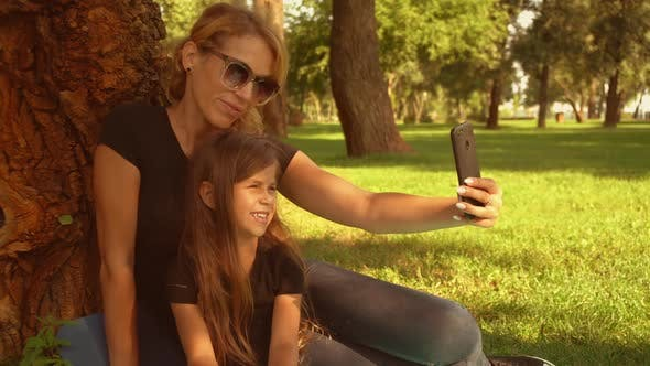 Thumbnail for Family Taking Selfies Outdoors