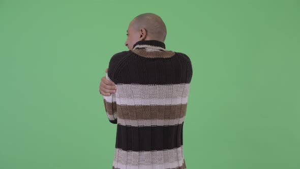 Thumbnail for Rear View of Bald Multi Ethnic Man Feeling Cold for Winter
