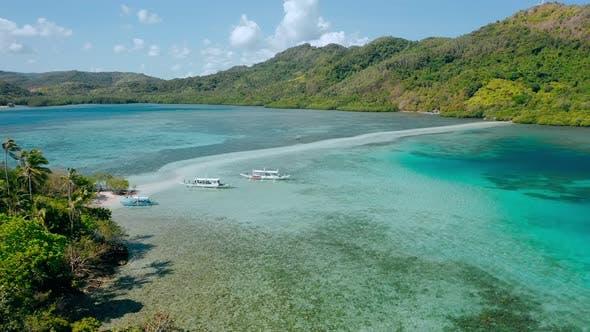 Thumbnail for Sandbar Near Snake Island with Turquoise Coastal Shallow Ocean Water. El Nido Archipelago