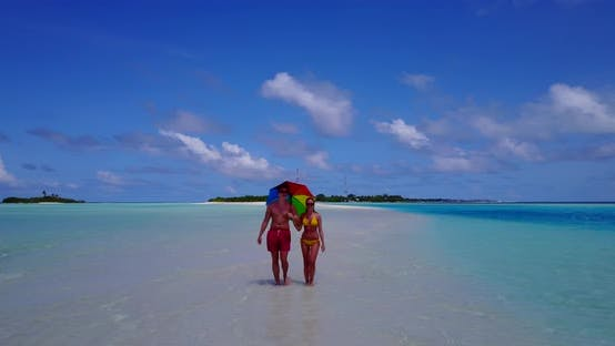 Thumbnail for Romantic man and woman on honeymoon vacation have fun on beach on white sand