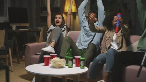 Friends Watching Sports Game On TV Together