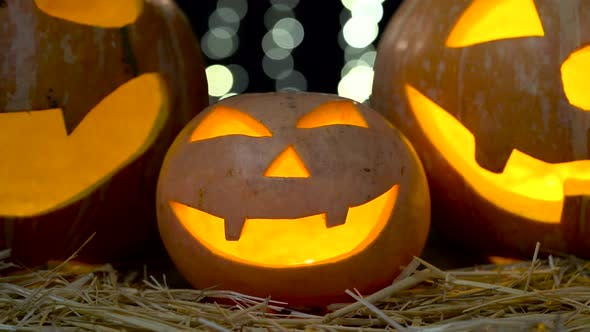 Thumbnail for Carved Halloween Pumpkin with Lights on Bokeh Background