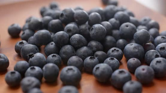 blueberry on wooden plate