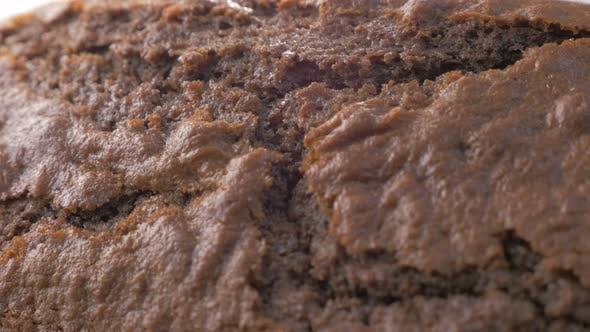 Thumbnail for Chocolate cake cracked surface slow panning 4K 2160p UltraHD footage - Slow panning over baked cake