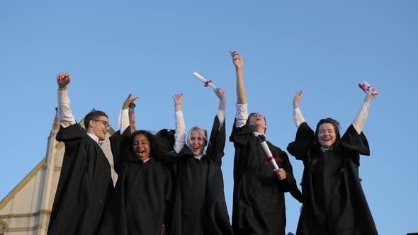 Cover Image for Group of Graduates Throwing Their Caps Up in the Air Happily
