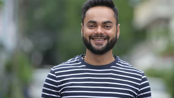 Thumbnail for Young Happy Bearded Indian Man Smiling Outdoors