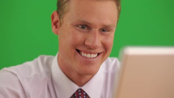Thumbnail for Close up of businessman on laptop computer getting good news