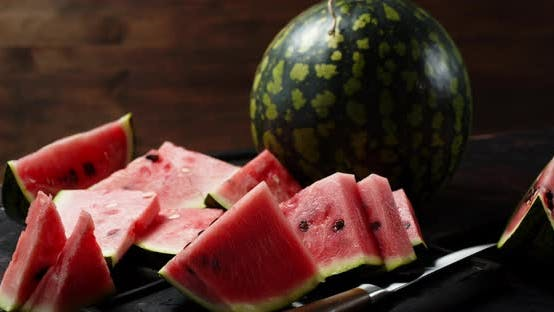 Pieces and Whole Watermelon on Table Will Slowly Rotate.