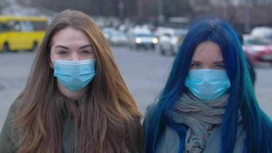 Thumbnail for Portrait of Brunette and Blue-haired Girls Wearing Protective Masks. Young Women Standing Outdoors