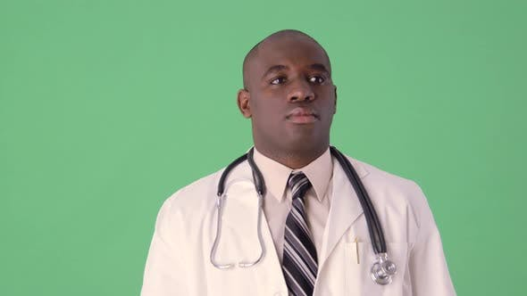 Thumbnail for African American Doctor using touch screen and futuristic display