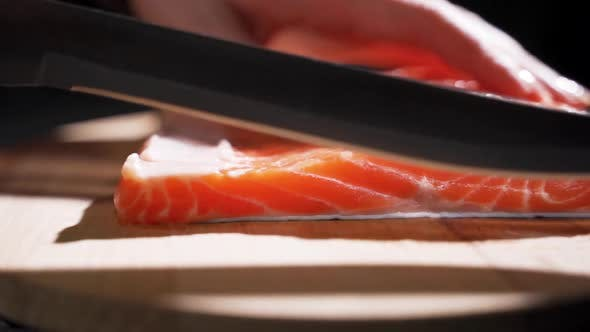 Thumbnail for The Cook Cuts Salmon Fillet