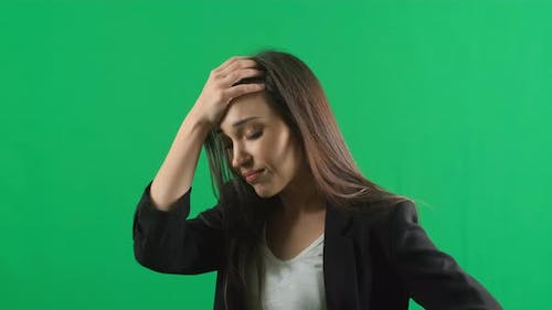 Horrible, Stress, Shock. Female Portrait Isolated at Green Screen Background. Young Emotional