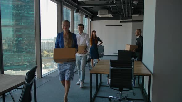 Thumbnail for Female Boss and Group of Cheerful Office Workers Walking Through Hallway Towards the Camera While