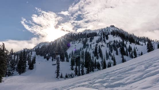 Thumbnail for Winter Mountain Resort Run And Chairlift Timelapse With Rolling Clouds