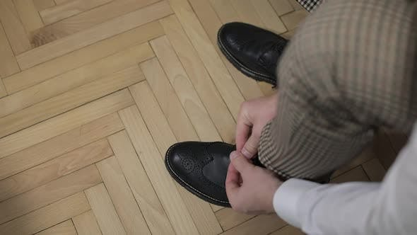 Thumbnail for Groom Putting His Wedding Shoes on Wedding Day. Hands of Wedding Groom