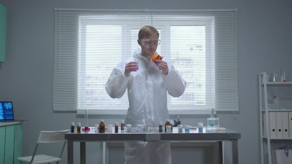 Thumbnail for Slow Motion, Man in Protective Workwear Smell Things in the Laboratory