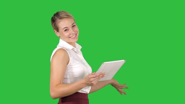Female Office Clerk Walking with Tablet and Smiling Broadly