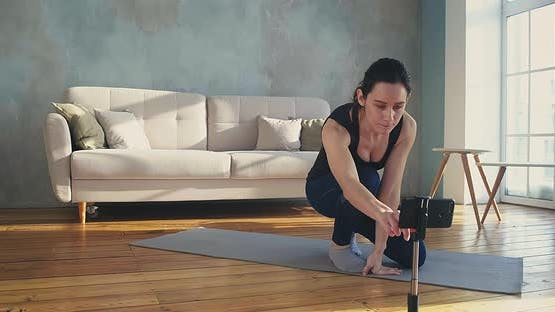 Woman Model Adjusts Phone and Shows Plank Shooting Video