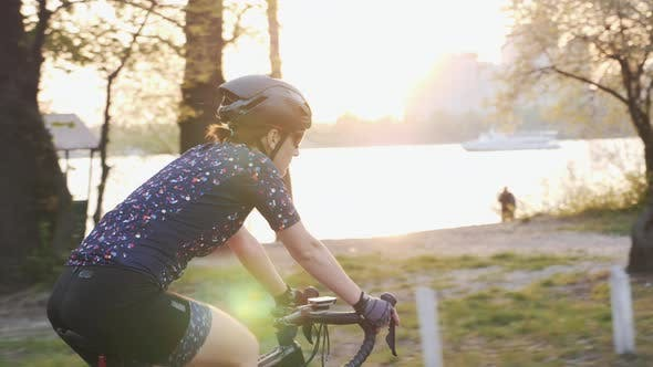 Female is riding bicycle