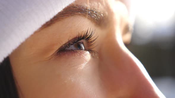Thumbnail for Detail View of Woman Brown Eyes Looking Around. Attractive Brown-eyed Girl Blinking and Admiring