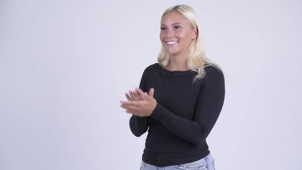 Cover Image for Young Happy Blonde Woman Clapping Hands