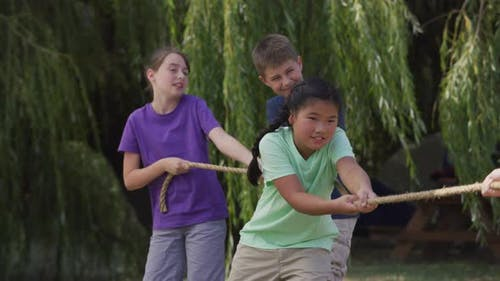 Kids at summer camp playing tug or war