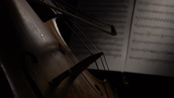 Thumbnail for Cello Close-up with Sheets of Notes