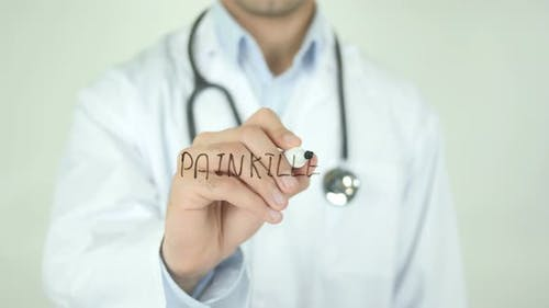 Painkiller, Doctor Writing on Transparent Screen