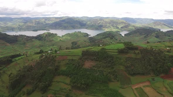 Thumbnail for Aerial view of Lake Bunyonyi and fields with crops