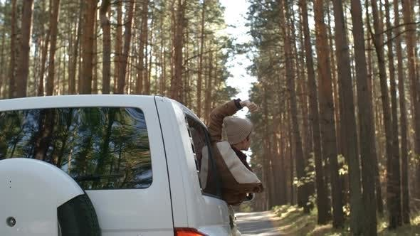 Thumbnail for Woman Enjoying Forest Out of Car