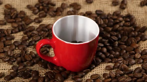 Thumbnail for Coffee Beans Falling Into Red Cup. Close Up