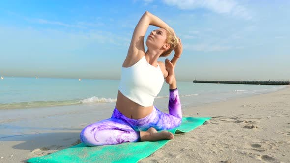 Thumbnail for Woman Doing Yoga Asana on the Beach