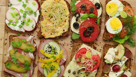 Colorful, Different Kinds Sandwiches Served on Wooden Chopping Board